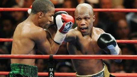 Zab Judah, right, lands a punch on Ernest