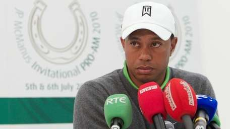 Tiger Woods speaks at a press conference at