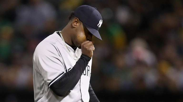 Luis Severino of the Yankees blows on his
