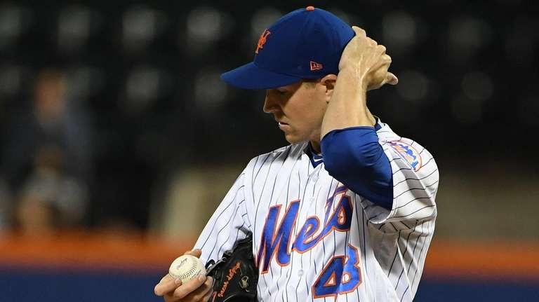 New York Mets starting pitcher Jacob deGrom stands