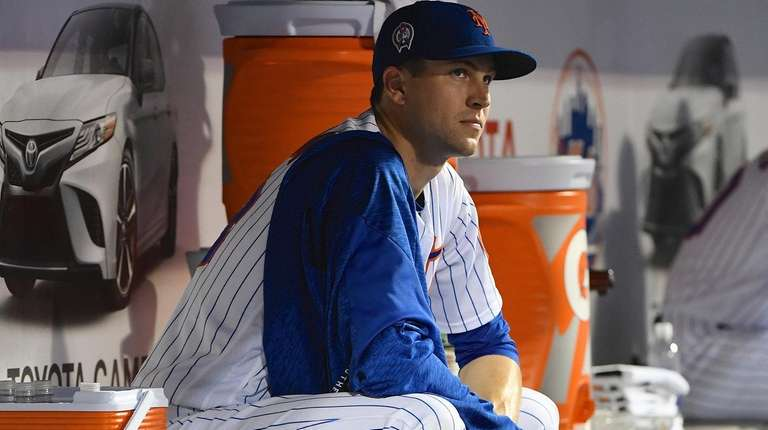 Mets starting pitcher Jacob deGrom looks on from