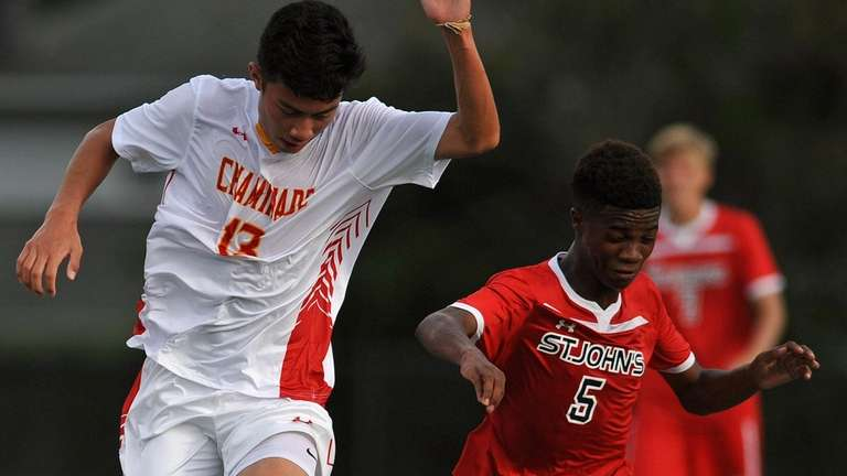 Jose Pena of Chaminade, left, and Shawn Adams