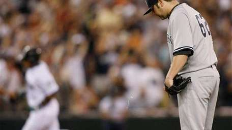 New York Yankees pitcher Joba Chamberlain reacts on