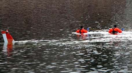 Suffolk County Police Marine Unit divers search near