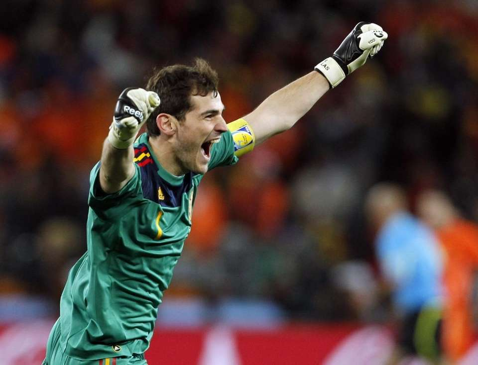 Spain goalkeeper Iker Casillas celebrates after Andres Iniesta