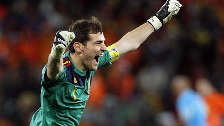 Spain goalkeeper Iker Casillas celebrates after Andres Iniesta