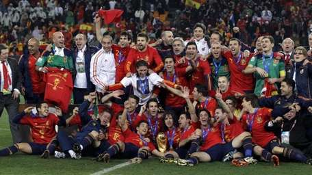The Spanish team pose for photographers with the