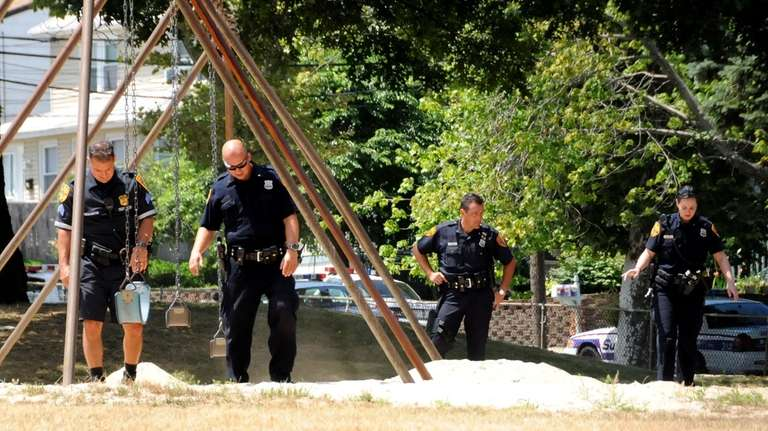 Officers comb a playground for bullet shell casings