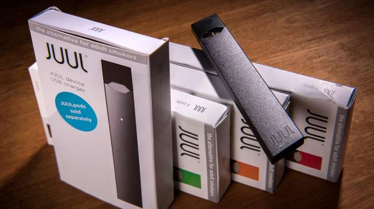 A Juul vaping system with accessory pods in