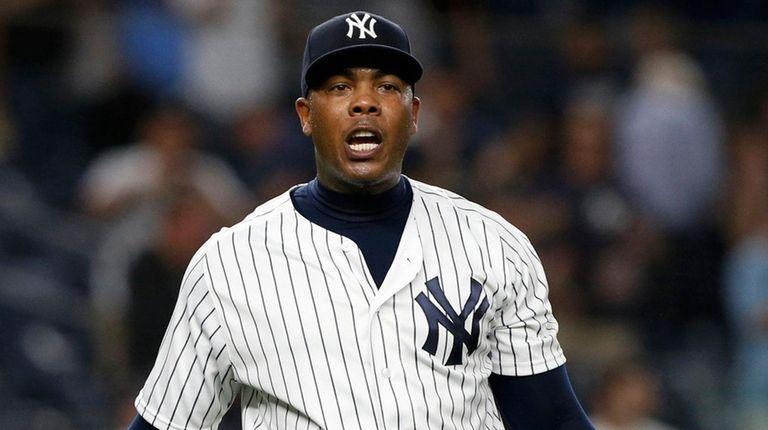 Yankees closer Aroldis Chapman reacts after the final