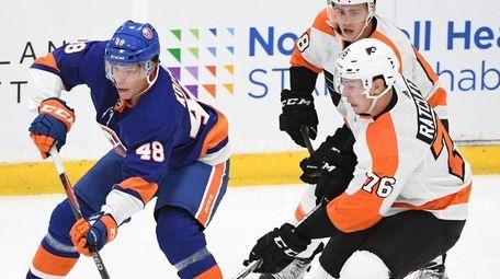 New York Islanders forward Otto Koivula skates against