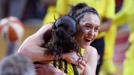 Seattle Storm forward Breanna Stewart, back, celebrates and