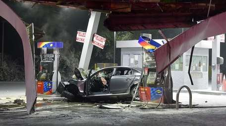The crash scene at the Sunoco gas station