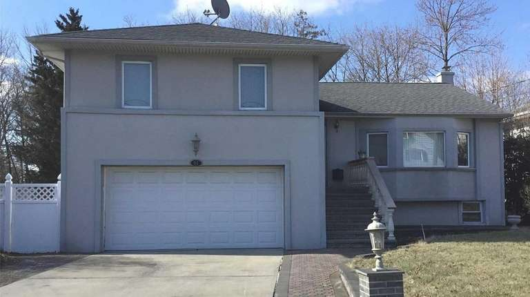 This East Rockaway split-level is listed for $599,000.
