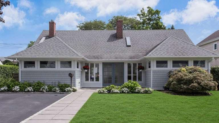 This East Rockaway expanded ranch is listed for