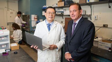 SBU chemistry professor Iwao Ojima, left, with James