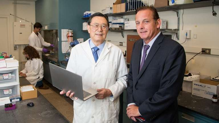 SBU chemistry professor Iwao Ojima, left, with James