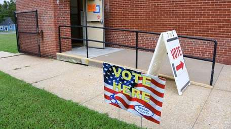 Signs direct voters toward the polling place at