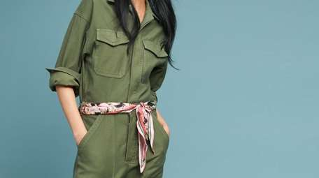 Utilitarian pockets and a cinched waist add interest