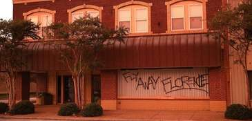 Businesses are boarded up on Wednesday before the