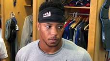 Giants running back Saquon Barkley talks to reporters