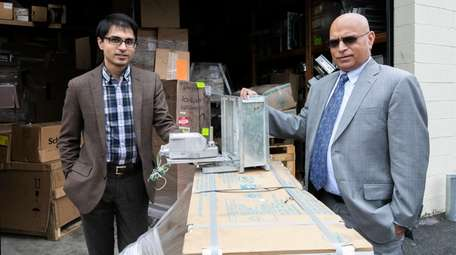 Fahd Reyaz, left, legal counsel of ACS System
