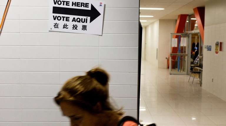 A woman leaves a polling site during primary