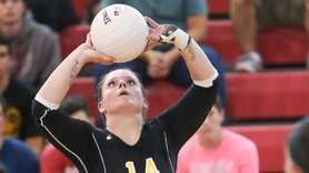 Wantagh's Kayla Rende sets the ball in the