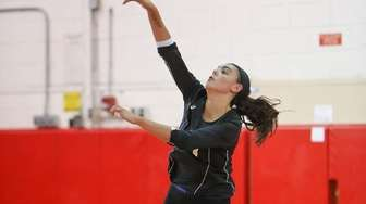 Wantagh's Julia Pugliese serves in the third game