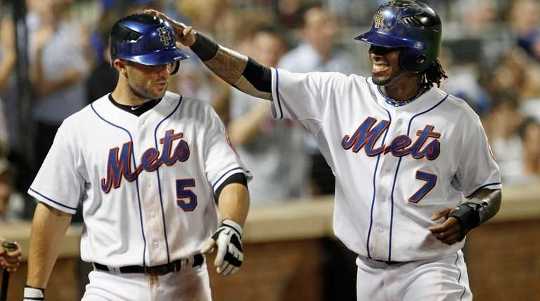 Mets shortstop Jose Reyes greets David Wright after