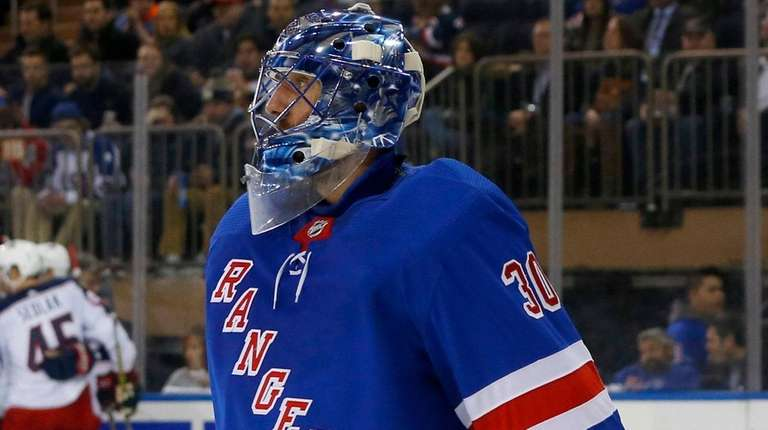 Rangers goalie Henrik Lundqvist reacts after surrendering a