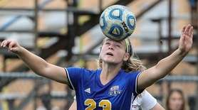Emma Terino of East Meadow heads the ball