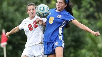 Riley Miller of Syosset battles East Meadow's Cristina