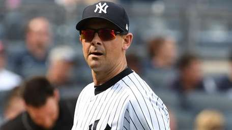 Yankees manager Aaron Boone looks on as he