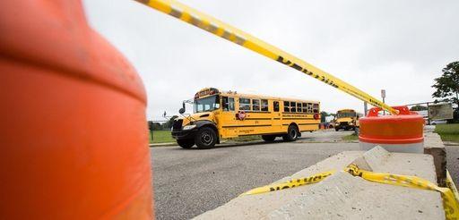 Buses depart Amityville Memorial High School by way