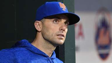 The Mets' David Wright looks on from the