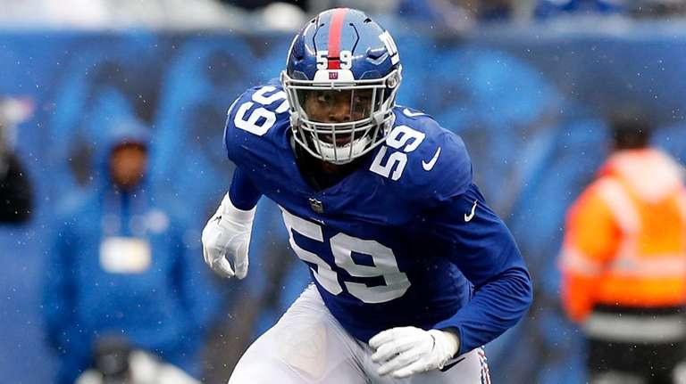Lorenzo Carter of the Giants in action against