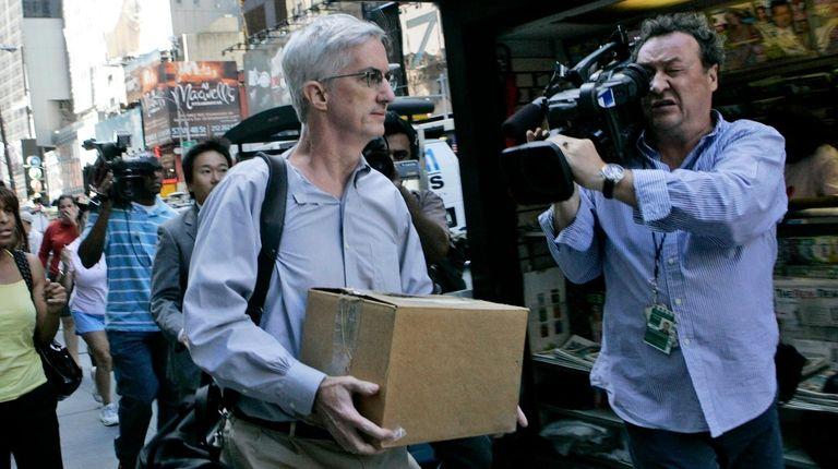 A man leaves Lehman Brothers headquarters in Manhattan