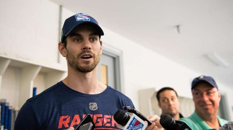New York Rangers defenseman Adam McQuaid (54) speaks