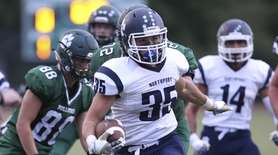 Northport's Justin Gerdvil scores a touchdown against Lindenhurst