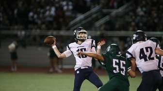 Northport's Sean Walsh fires a pass against Lindenhurst