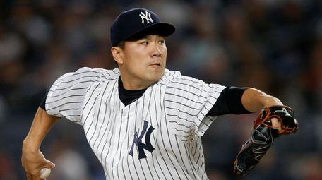 Masahiro Tanaka #19 of the Yankees pitches against