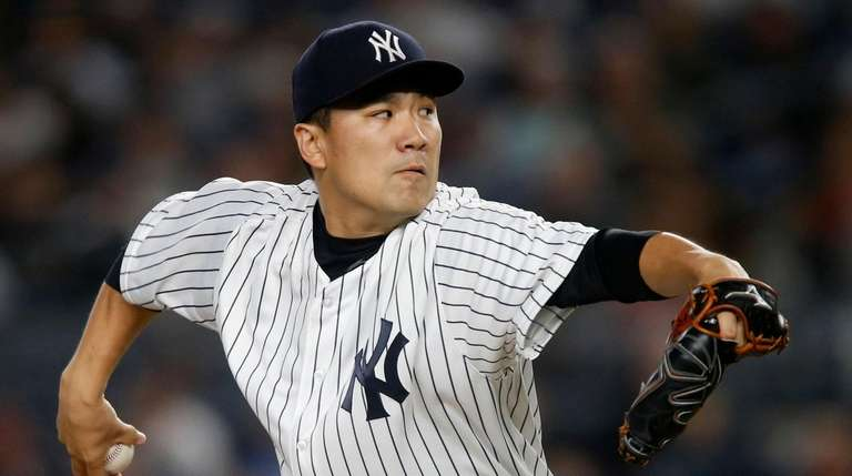 Masahiro Tanaka #19 of the Yankees pitches against