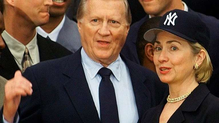 George Steinbrenner talks to Hillary Clinton at the