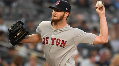 Boston Red Sox starting pitcher Chris Sale delivers