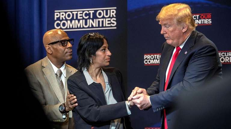 President Donald Trump talks to Freddy Cuevas and