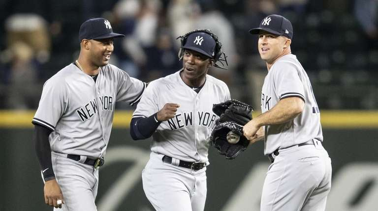 Outfielders Aaron Hicks, Andrew McCutchen and Brett Gardner