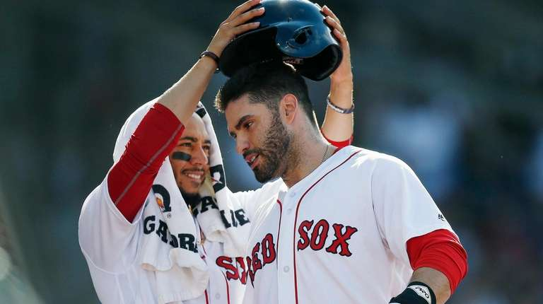 Mookie Betts, left, and J.D. Martinez, shown here