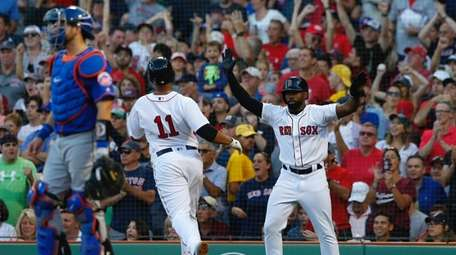 Boston Red Sox' Jackie Bradley Jr (R) celebrates