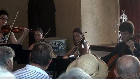 Chamber players perform Vivaldi at Planting Fields Arboretum.